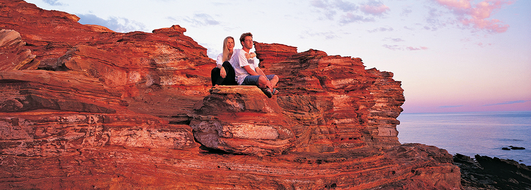 Australia; Western Australia; Broome; Gantheaume Point; Couple on rocky cliff