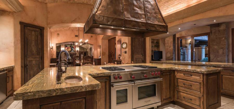 Kitchen opens to living areas