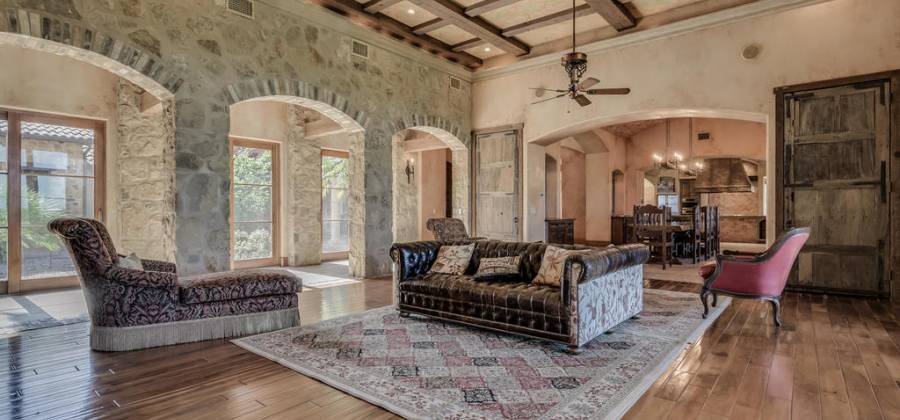 Large living with beamed ceilings