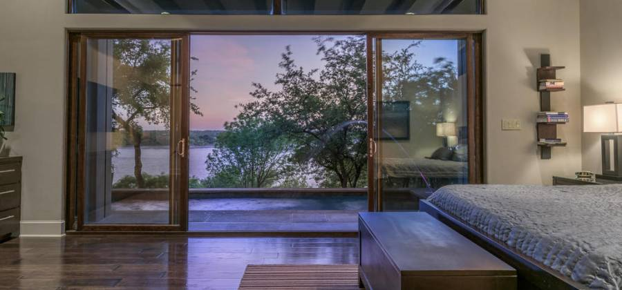 Open sliding doors to pool and views of Lake Travis