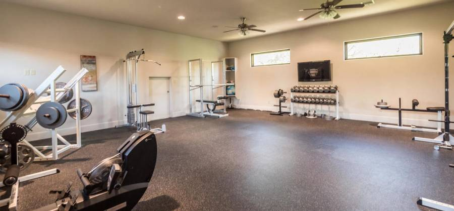 Very large hidden exercise room next to game room